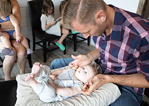 Chiropractor Burlington WI Brett Moran Treating Colicky Baby